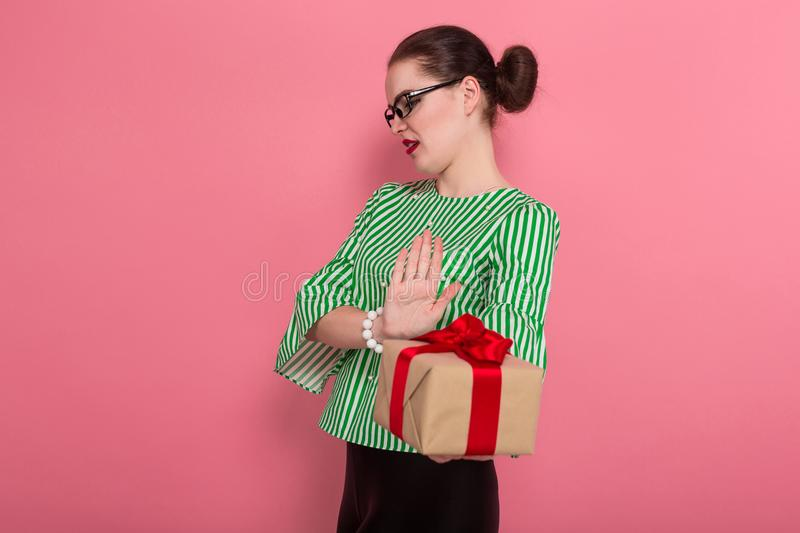 Businesswoman with hair bun and present royalty free stock image
