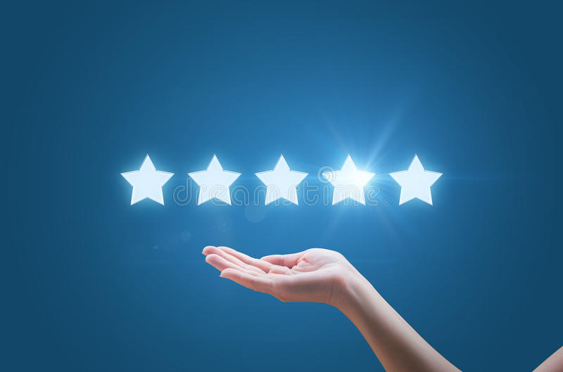 Businesswoman hand holding five stars isolated stock photography