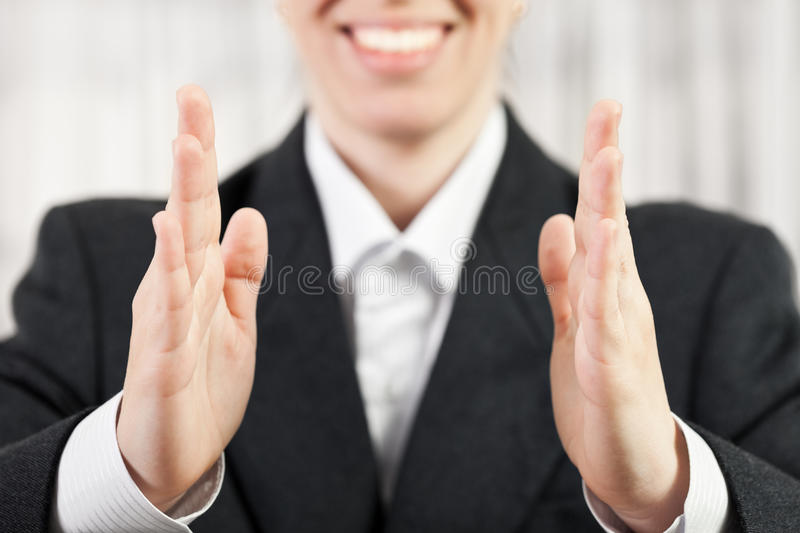 Businesswoman hand showing middle size stock image