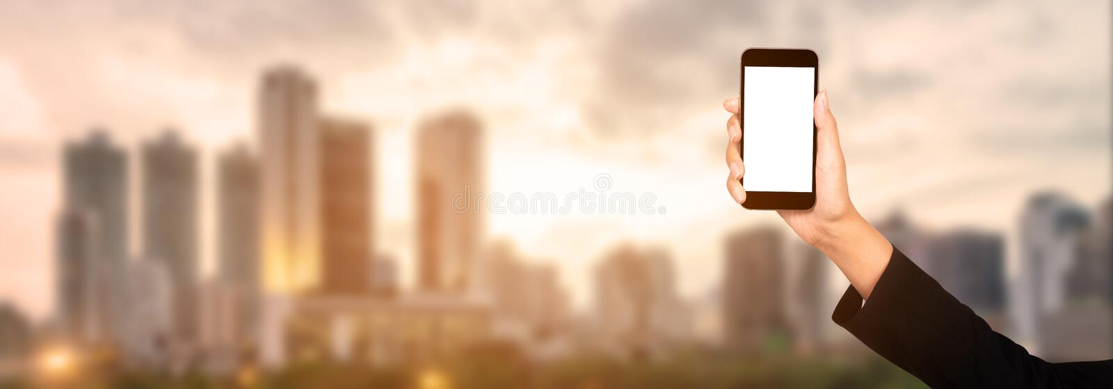 Businesswoman hand using mobile smartphone with white screen, ci stock image