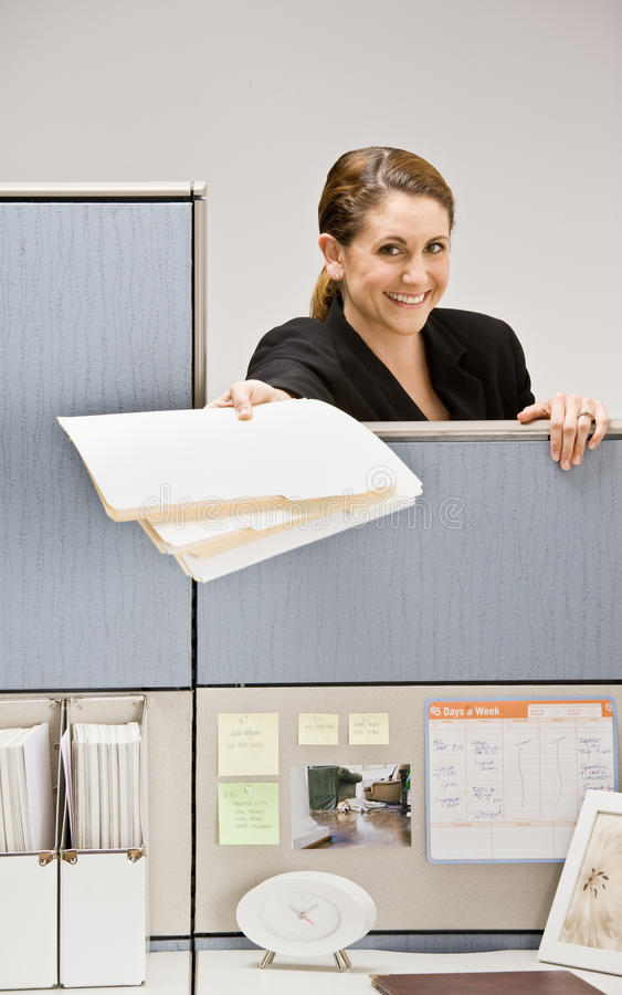 Free Businesswoman Handing Co-worker File Folder Stock Images - 17054754
