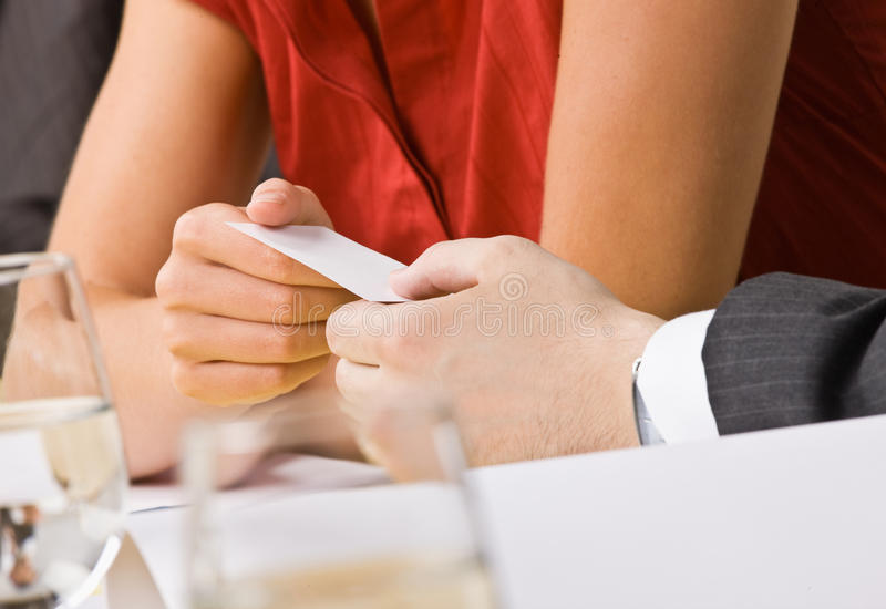 Download Businesswoman Handing Co-worker Her Business Card Stock Image - Image: 17052209