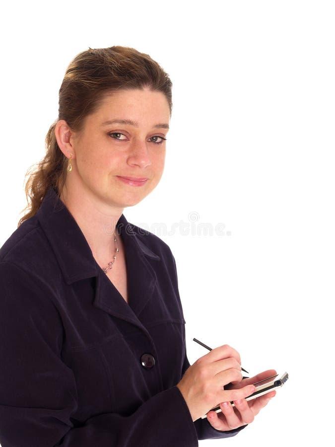 Businesswoman handing a pda royalty free stock photos