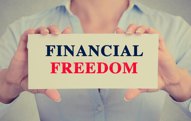 Businesswoman hands holding card sign with Financial freedom message stock images