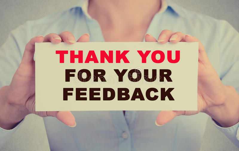 Businesswoman hands holding card with Thank you for your feedback message stock photography