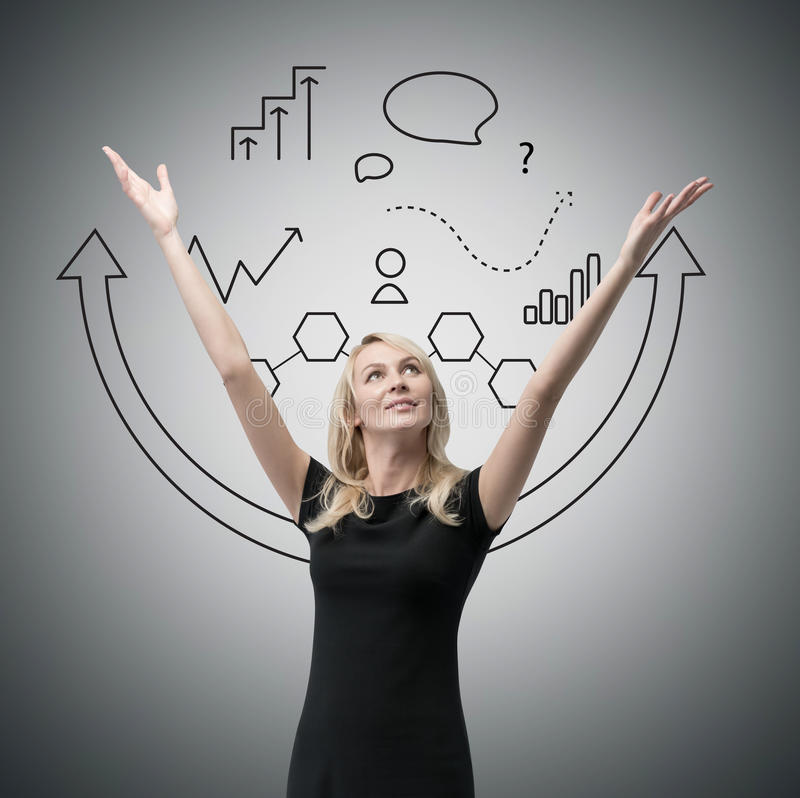 Businesswoman with hands raised up, stock image