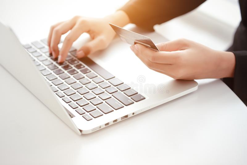 Businesswoman hands shopping and online payment by using laptop computer credit card stock image