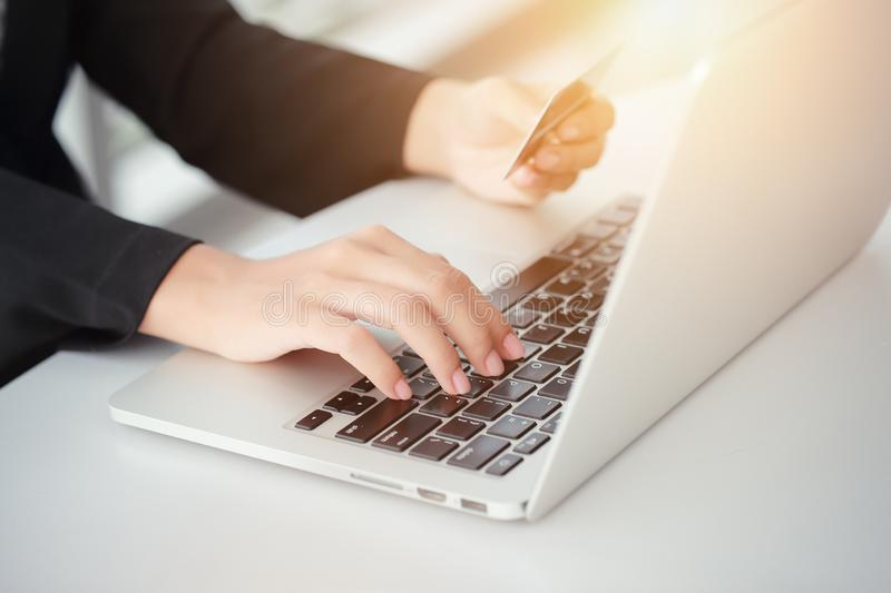 Shopping and online payment by using laptop computer and tablet with credit card. Businesswoman hands shopping and online payment by using laptop computer with royalty free stock photography