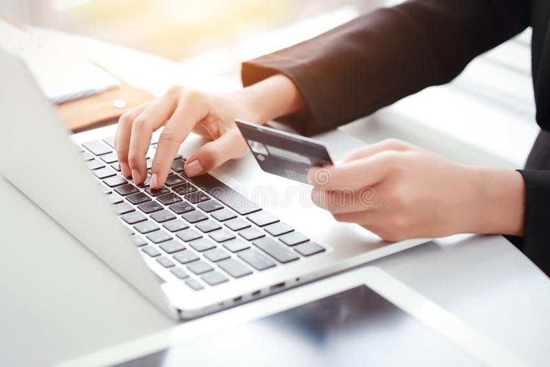 Shopping and online payment by using laptop computer and tablet with credit card. Businesswoman hands shopping and online payment by using laptop computer and royalty free stock image