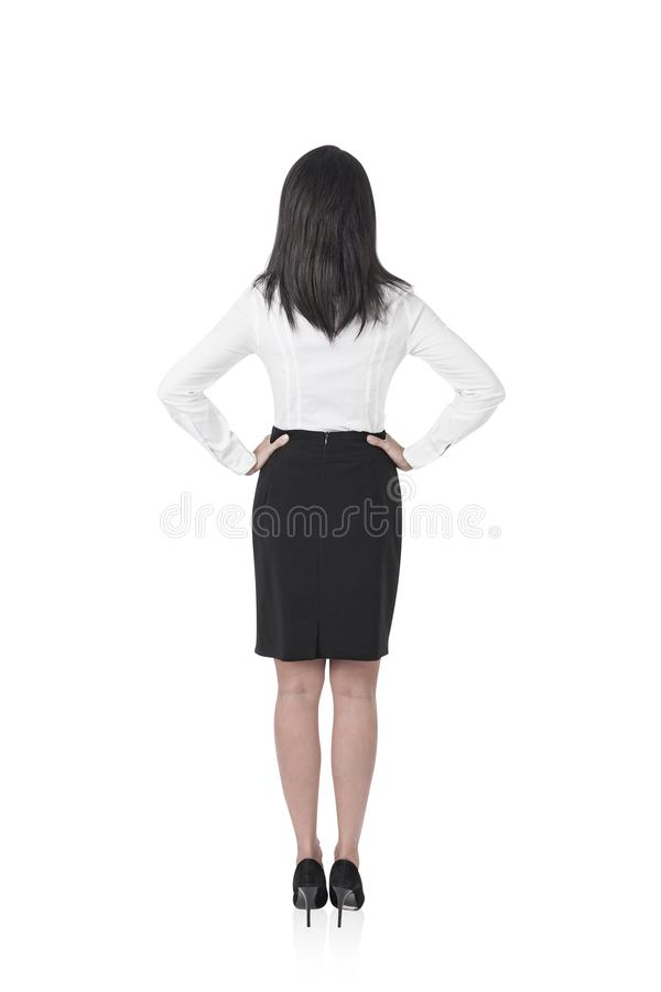 Businesswoman with hands on waist, isolated stock photos