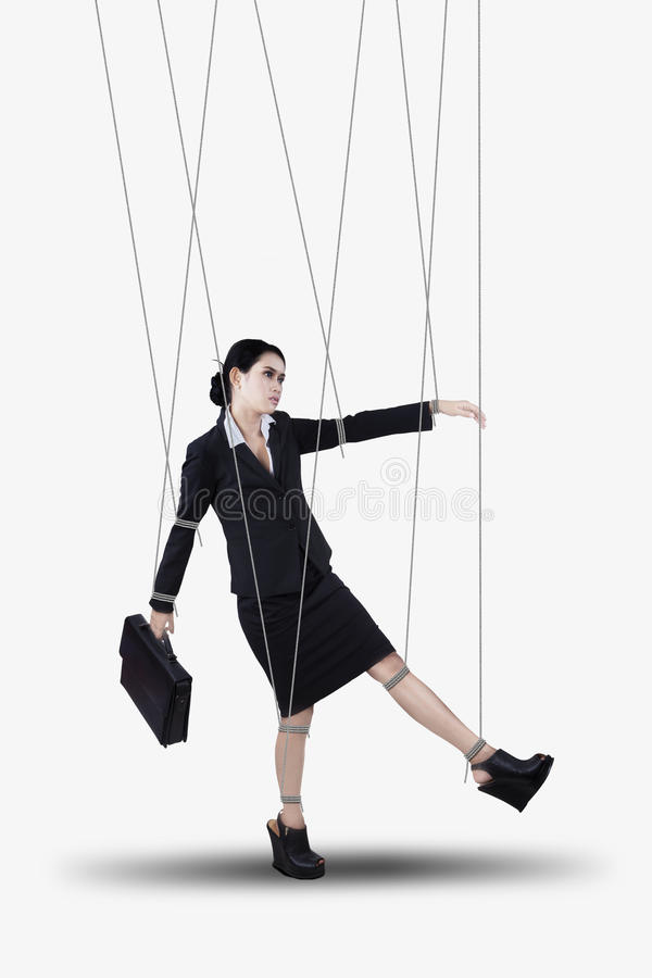 Businesswoman hanging on strings stock photo