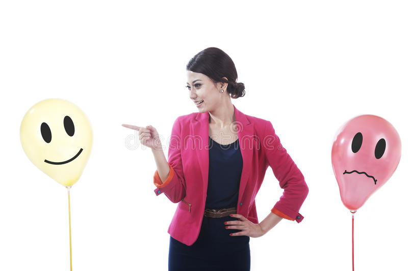 Businesswoman with happy and sad clients. Pretty business woman pointing to happy customer isolated on white royalty free stock photography
