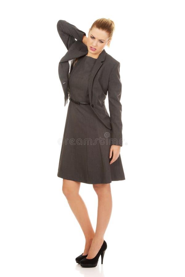 Businesswoman having neck pain. stock images