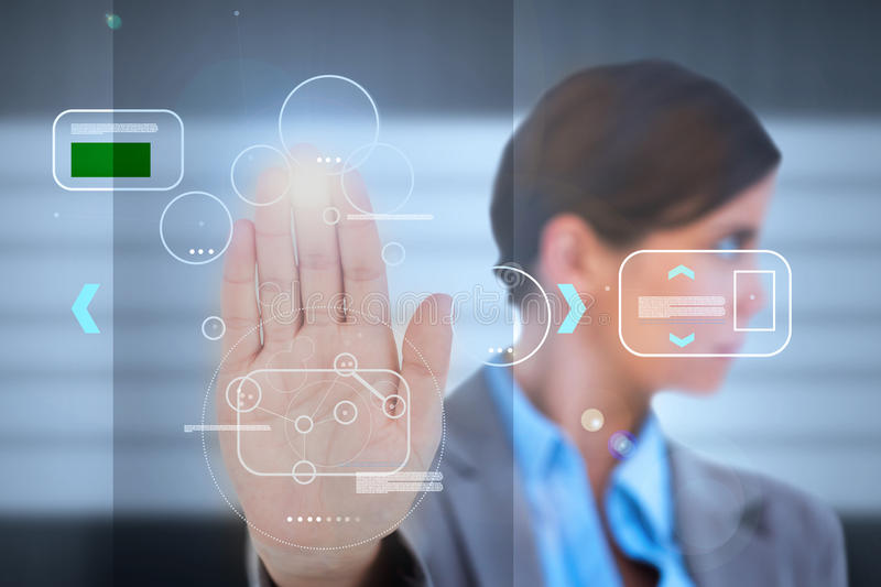 Businesswoman having a palm print identification. For a security entrance stock image
