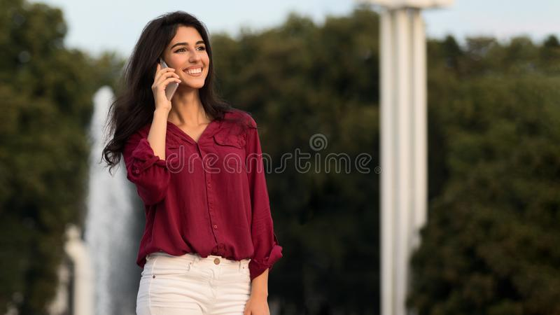 Businesswoman having phone talk, walking in the city during break stock images