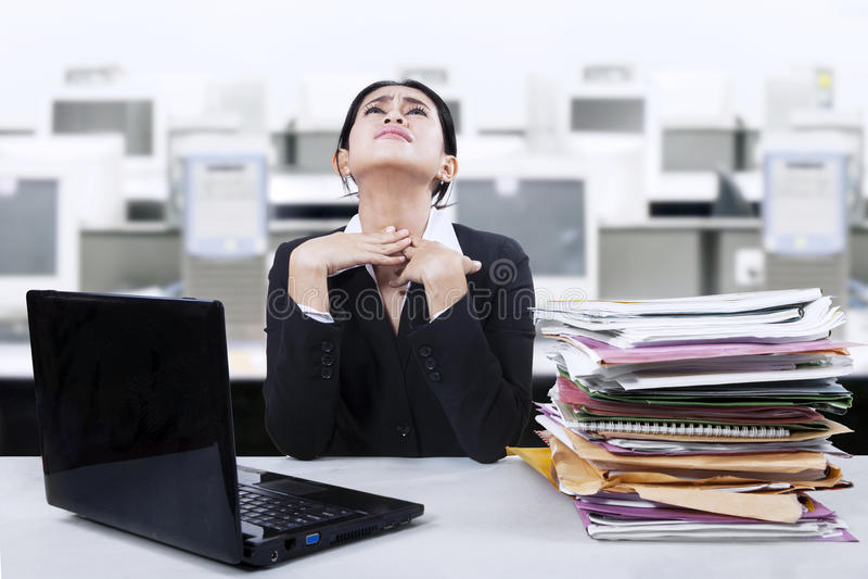 Businesswoman having sore throat stock images