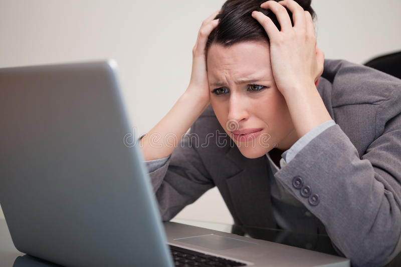 Businesswoman having trouble with her notebook stock images