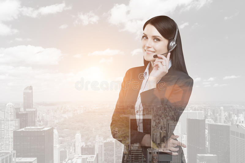 Businesswoman with headset in a city stock photo