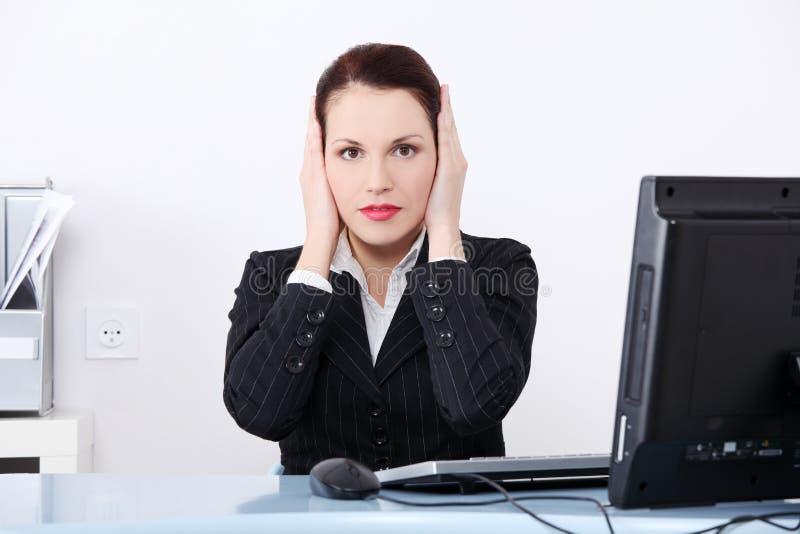 Businesswoman in the hear no evil pose. stock photo