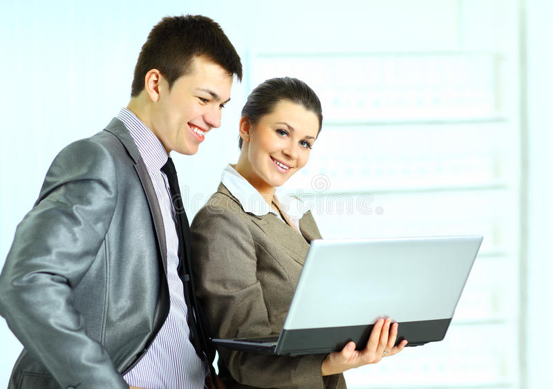 Download Businesswoman With Her Colleagues Using Laptop Stock Photo - Image: 25396686