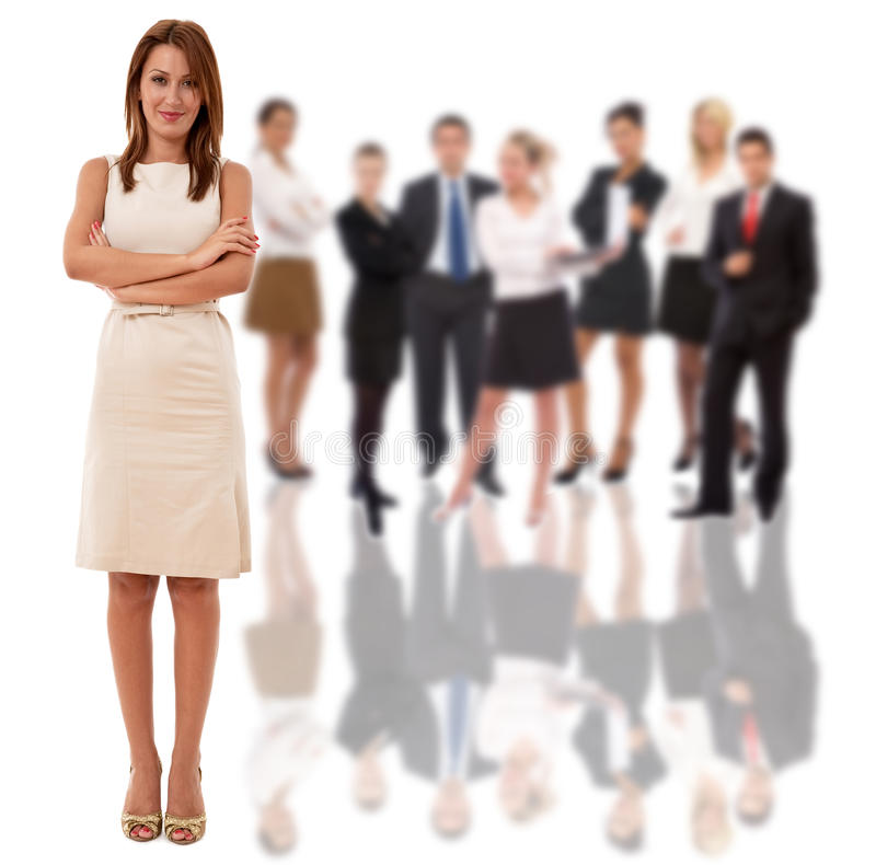 Businesswoman and her team. Businesswoman as a leader and her business team in back stock images