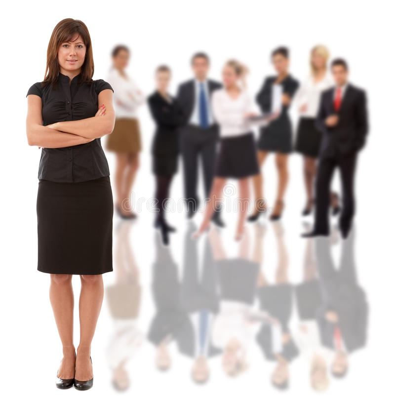 Businesswoman and her team. Businesswoman as a leader and her business team in back royalty free stock photo