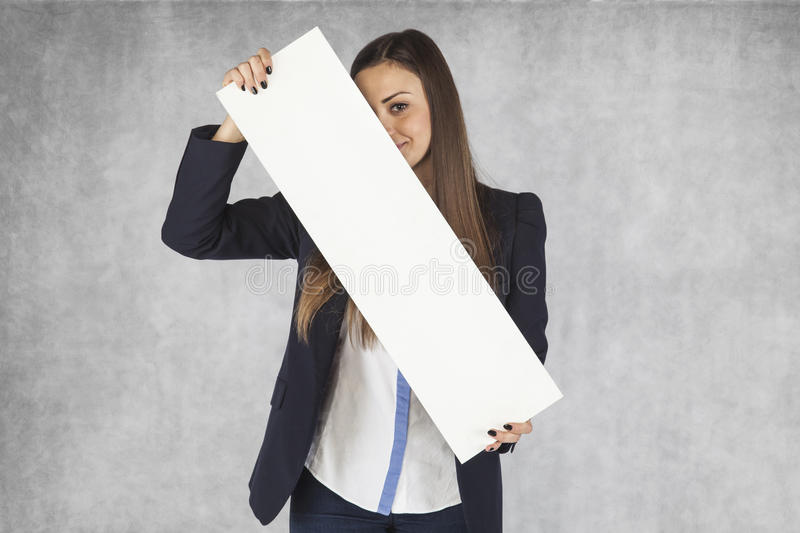 Businesswoman hides behind billboards stock image