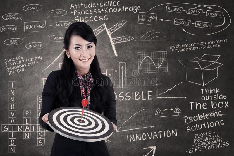 Businesswoman Hold Bull S Eye In Class Royalty Free Stock Images