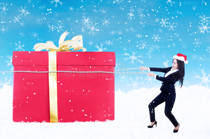 Businesswoman hold christmas gift with chain