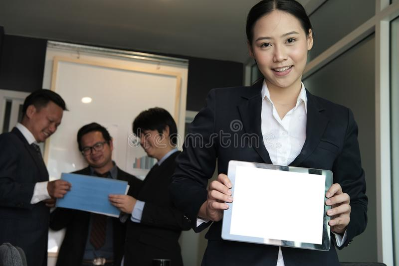 Businesswoman hold tablet at workplace. young woman shows inform royalty free stock photography