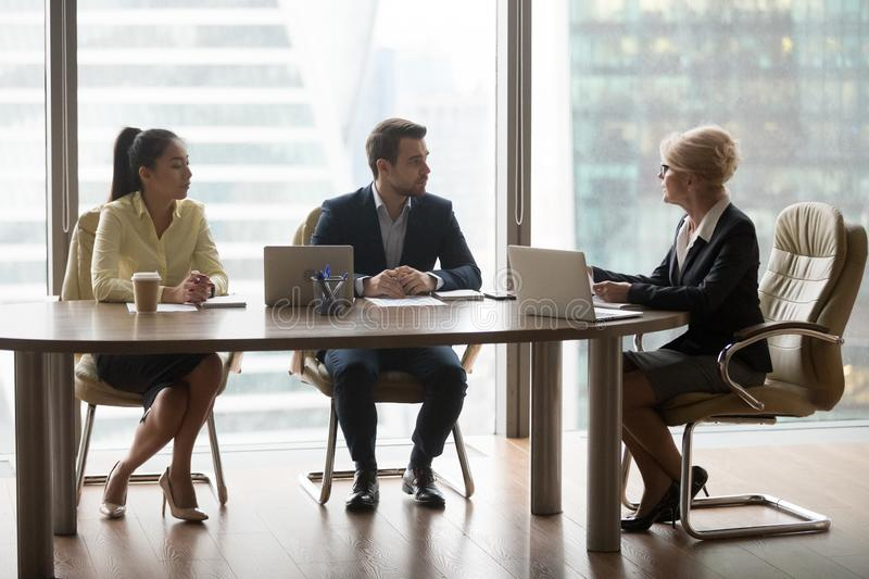 Businesswoman hold discussion at office business meeting stock photos