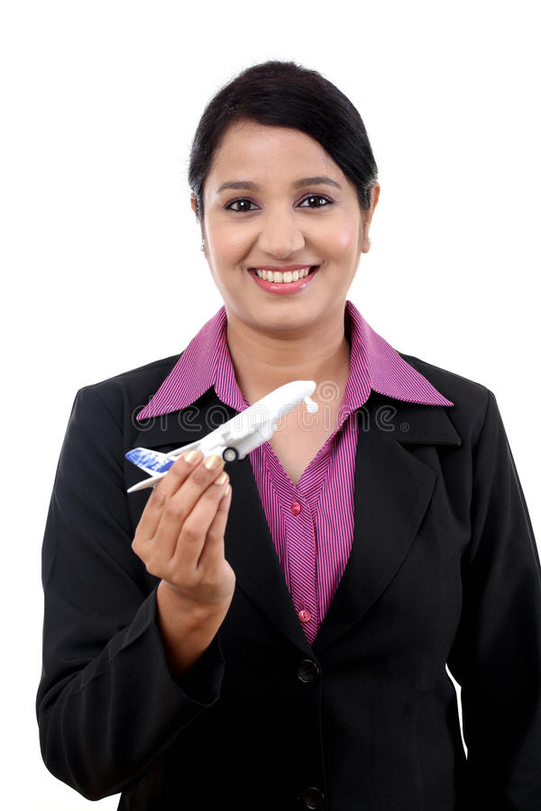 Businesswoman holding airplane miniature stock photography