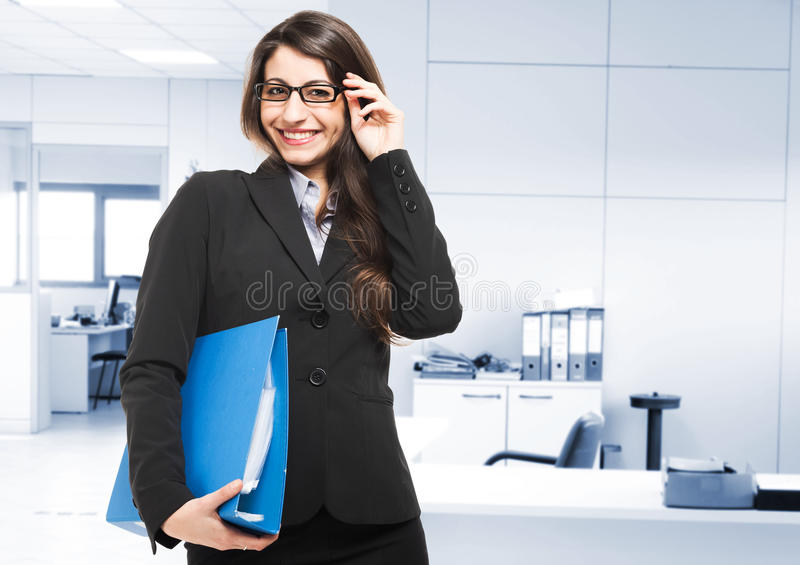 Businesswoman holding a binder stock images