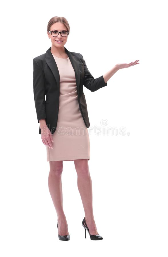 Businesswoman holding blank copy space on her open palm standing in full length royalty free stock image