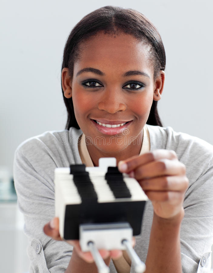 A businesswoman holding a business card holder