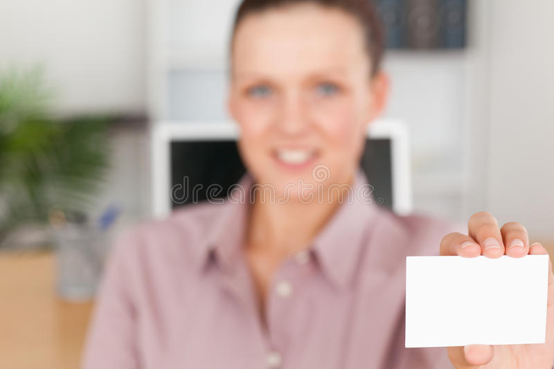 Download Businesswoman Holding A Card Stock Photo - Image: 20685852