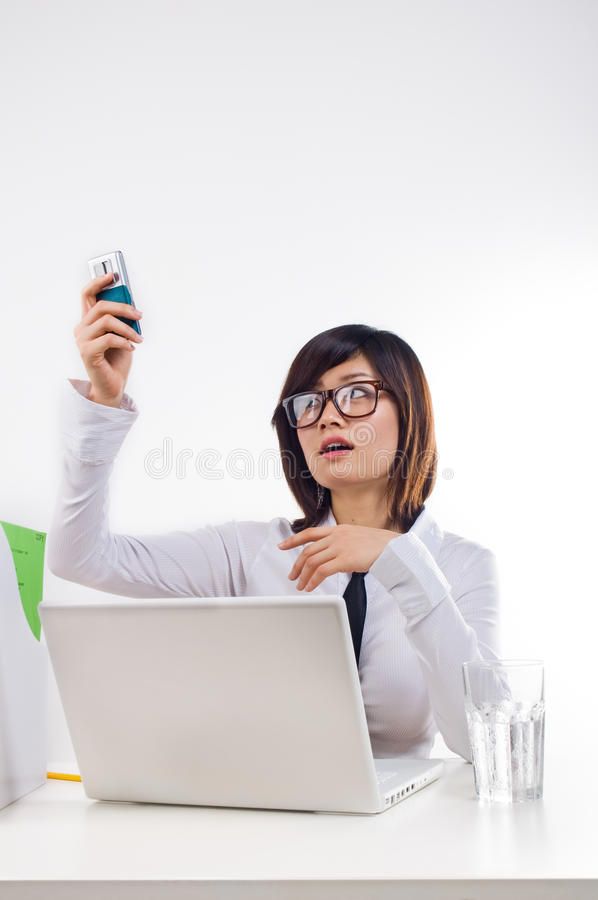 Businesswoman holding cellphone stock photo