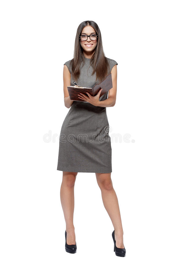 Businesswoman holding clipboard stock image