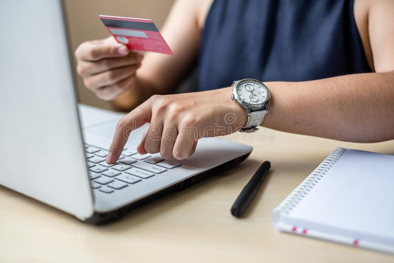 Businesswoman holding credit card for online shopping while making orders via the Internet. business, technology, ecommerce and royalty free stock photography