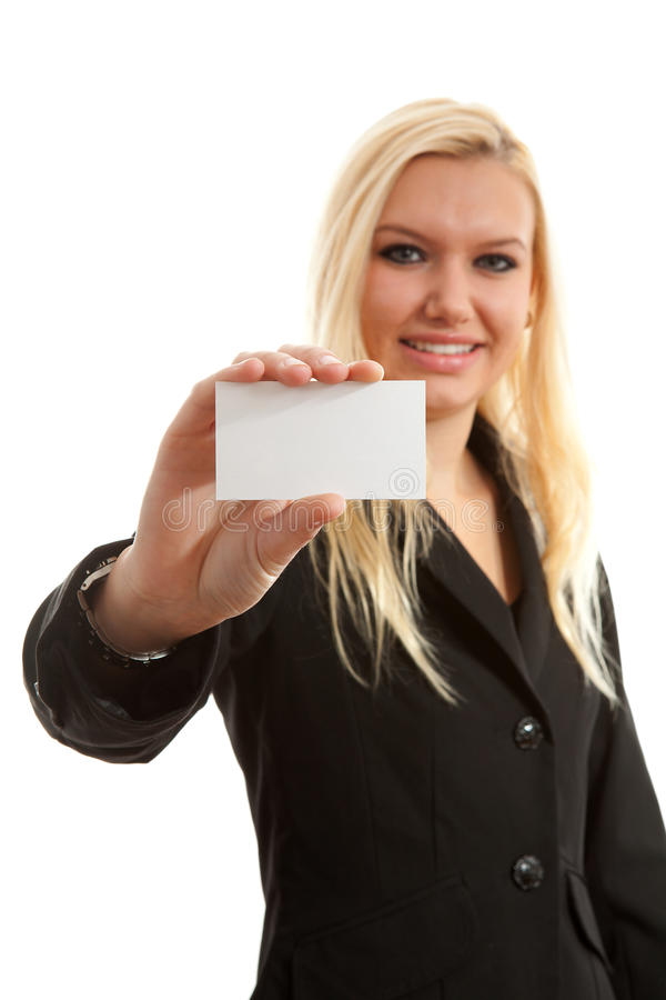 Businesswoman is holding empty card. Businesswoman is holding empty business card over white background, woman is blurred royalty free stock images