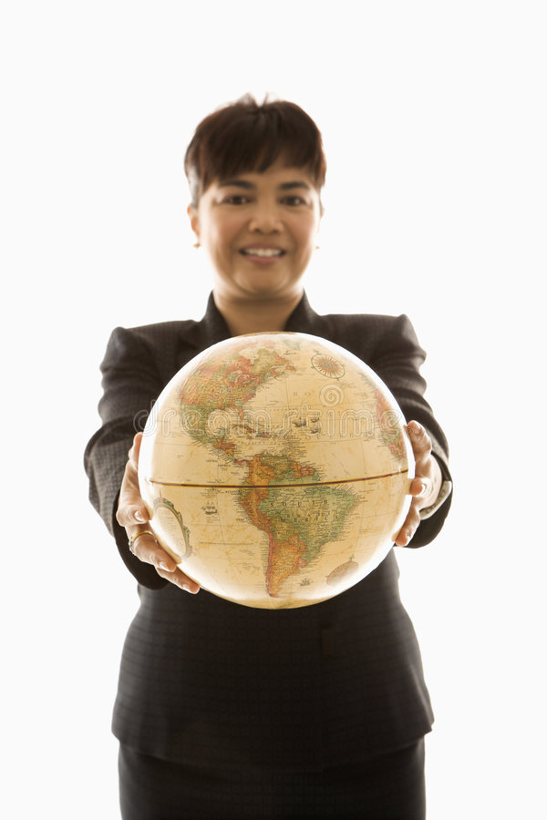Businesswoman holding globe. Filipino middle-aged businesswoman holding globe in both hands standing in front of white background royalty free stock photos