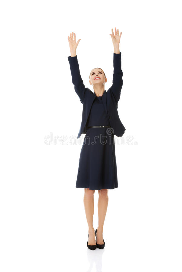 Businesswoman holding hands up stock images