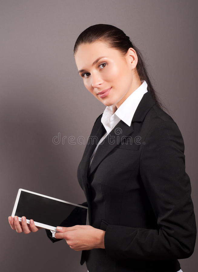 Download Businesswoman Holding Her Digital Tablet Pc Stock Image - Image: 27787411