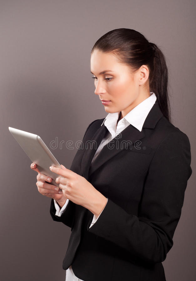 Download Businesswoman Holding Her Digital Tablet Pc Stock Image - Image: 27787441