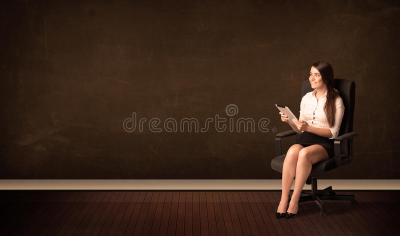 Businesswoman holding high tech tablet on background with copysp stock photos