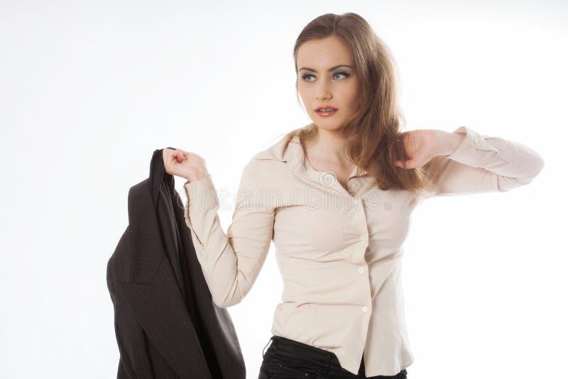 Businesswoman holding jacket royalty free stock image