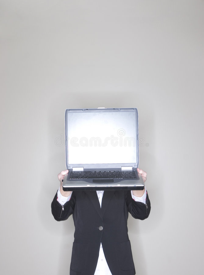Businesswoman holding laptop royalty free stock photography