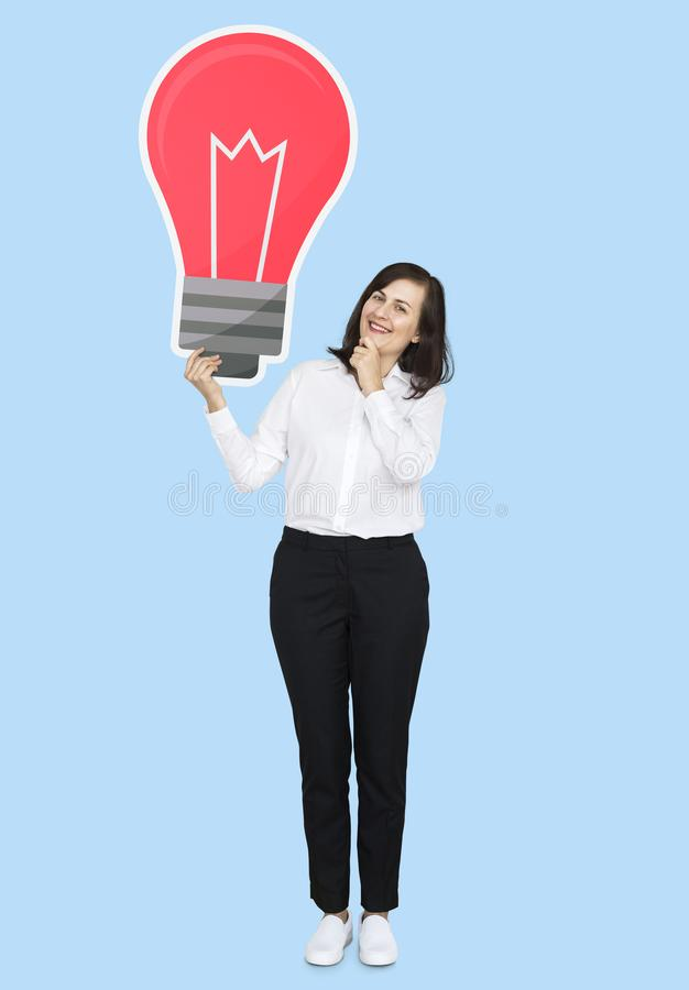 Businesswoman holding a light bulb royalty free stock images