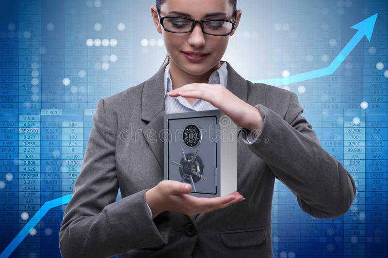 The businesswoman holding metal safe in security concept royalty free stock photo