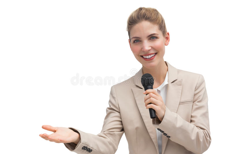 Businesswoman holding microphone royalty free stock image